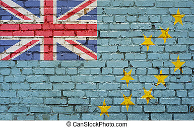 Flag of Tuvalu painted on brick wall, background texture