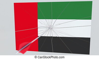 Flag of UAE plate being hit by archery arrow. Conceptual 3D...
