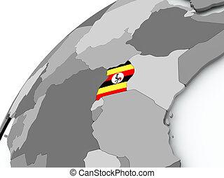 Flag of Uganda on grey globe
