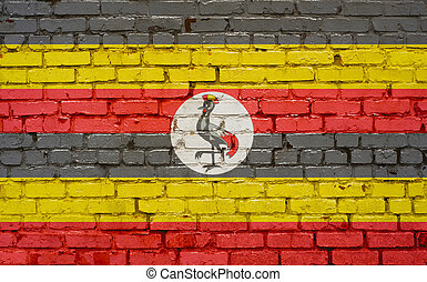 Flag of Uganda painted on brick wall, background texture