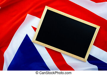 Flag of UK, British flag with blackboard, close up. Top view, copy space for text.