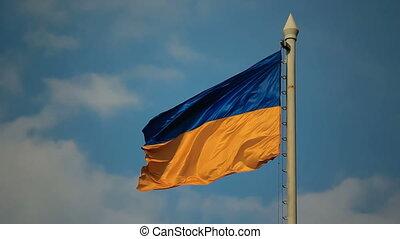 Flag of Ukraine against cloudy sky - Flag of Ukraine against...