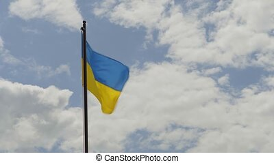 Flag of Ukraine against the backdrop of a beautiful cloudy sky