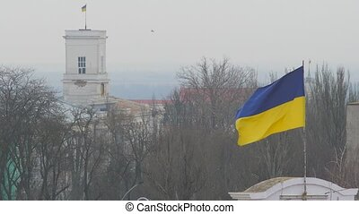 Flag of Ukraine flutters upon annex Crimea. Disputed...