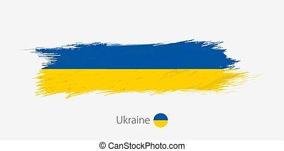 Flag of Ukraine, grunge abstract brush stroke on gray background.