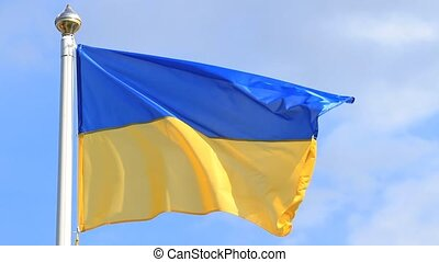 Flag of Ukraine on blue sky background.