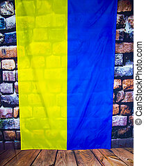 Flag of Ukraine on the background of a stone wall - Independence Day.
