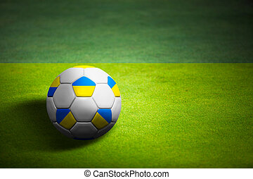 Flag of Ukrains with soccer ball over grass background -...