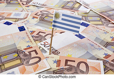 Flag of Uruguay sticking in 50 Euro banknotes.(series)