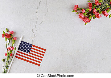 Flag of USA with red flowers.