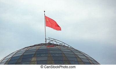 Flag of USSR in Minsk - Waving flag over the coat of arms of...