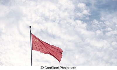 Flag of USSR on nature - Waving flag over the coat of arms...