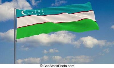 Flag of Uzbekistan against background clouds sky