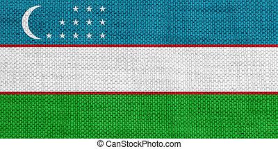 Flag of Uzbekistan on old linen