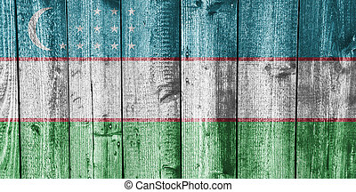 Flag of Uzbekistan on weathered wood