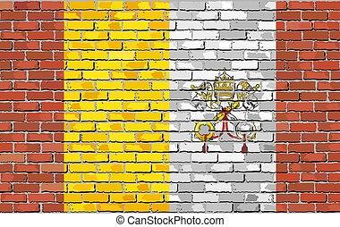 Flag of Vatican City on brick wall