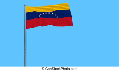 Flag of Venezuela on the flagpole fluttering in the wind on...