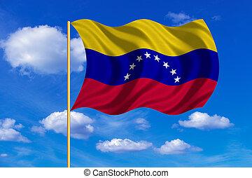 Flag of Venezuela waving on blue sky background