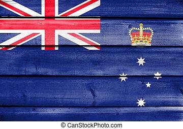 Flag of Victoria State, Australia, painted on old wood plank...