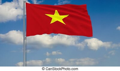 Flag of Vietnam against background of clouds sky