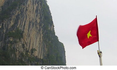 Flag of Vietnam blowing on a speedboat on the sea