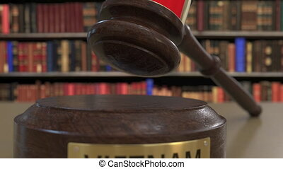 Flag of Vietnam on falling judges gavel in court. National...