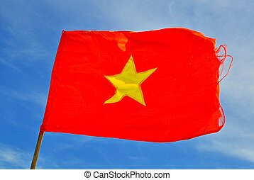 Flag of Vietnam with blue sky on background