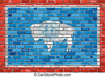 Flag of Wyoming on a brick wall