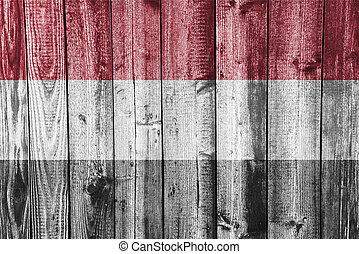 Flag of Yemen on weathered wood