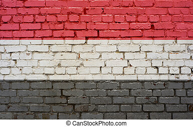 Flag of Yemen painted on brick wall, background texture