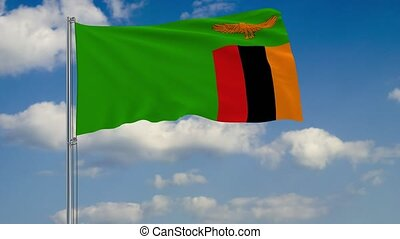 Flag of Zambia against background of clouds sky