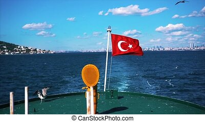 flag on a boat fluttering in the wind