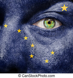 Flag painted on face with green eye to show Alaska support