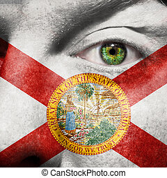 Flag painted on face with green eye to show Florida support