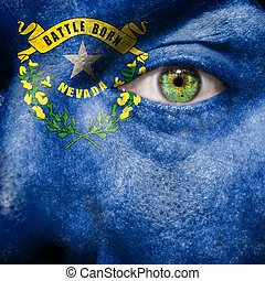 Flag painted on face with green eye to show Nevada support