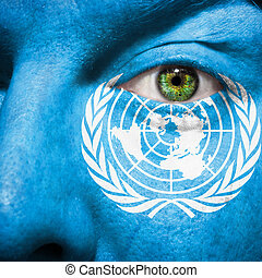 Flag painted on face with green eye to show UN support - ...