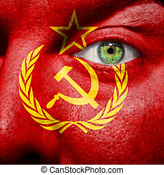 Flag painted on face with green eye to show USSR support