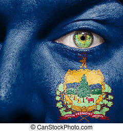 Flag painted on face with green eye to show Vermont support
