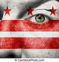 Flag painted on face with green eye to show Washington DC ...
