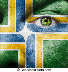 Flag painted on face with green eye to show Portland support