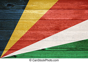 Flag painted on old wood plank background.
