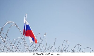 Flag Russian waving on blue sky barbed wire Concept liberty censor 4k