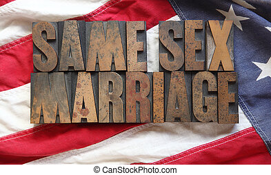 the words 'same sex marriage' on an old USA flag