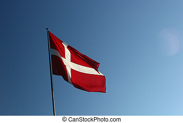 danish flag in the wind a sunny summer day Some lense flare
