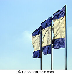 Flagpoles - Flags set on the flagpole, and flown in the wind