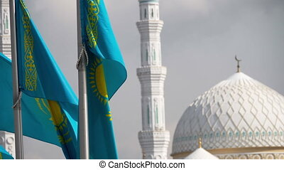 Flags and dome of mosque - Flag of Republic of Kazakhstan on...