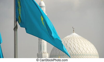 Flags and dome of mosque - Flags of Republic of Kazakhstan...