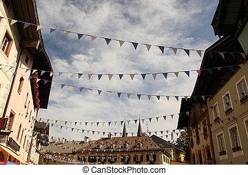 flags crossing historic street
