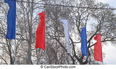 Flags fluttering in the wind - Red, blue and white flags...