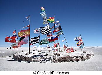 Flags in a salt desert of Uyuni